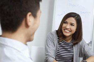 Young Woman smiling at a man